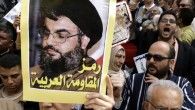 Protestors hold up a portrait of Hasan Nasrallah