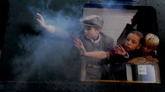 "Children rescued by Nicholas Winton leaving Prague, in scene from ""Nicky's Family."""