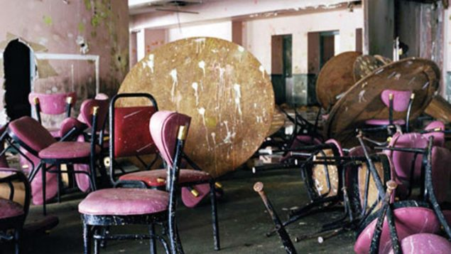 Pink chairs and overturned tables in the dining room of the Pines Country Club in South Fallsburgh. Marisa Scheinfeld