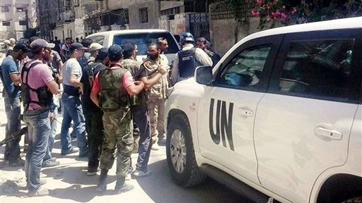 UN inspectors are escorted by Syrian rebels in Damascus in August, 2013 (photo credit: AP/United media office of Arbeen)