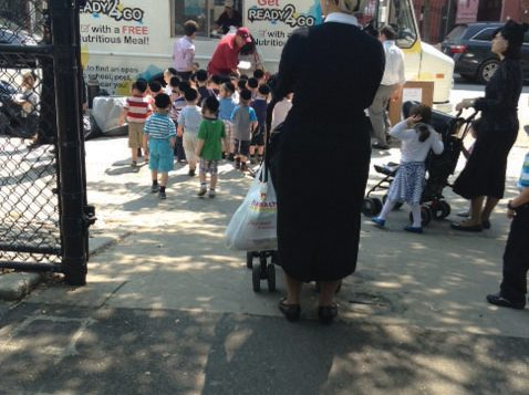 Kids in Williamsburg line up for free kosher lunches provided by a Met Council program.
