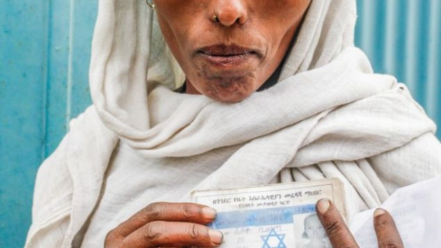 An Ethiopian women gets clearance to immigrate to Israel. Robyn Spector