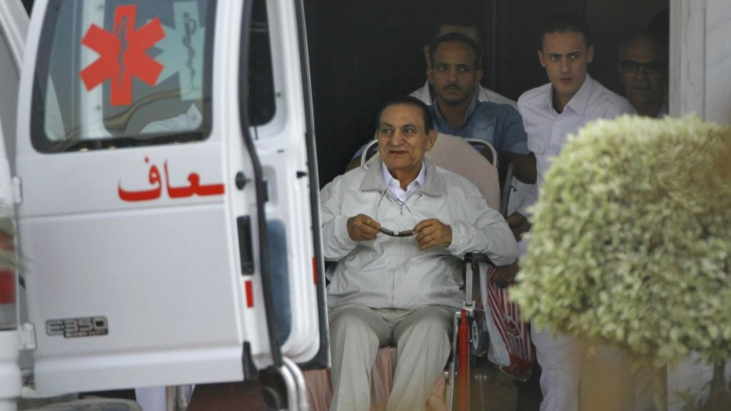 Former Egyptian president Hosni Mubarak, 85, is escorted by medical and security personnel into an ambulance en route from Maadi Military Hospital to the Cairo Police Academy-turned-court, Cairo, Egypt, Sunday, Aug. 25, 2013 (photo credit: AP/Amr Nabil)