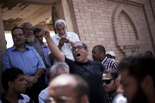 "A friend of Ammar Badie, 38, killed Friday by Egyptian security forces during clashes in Ramses Square, and also son of Muslim Brotherhood's spiritual leader Mohammed Badie, shouts, ""Allah is the greatest,"" while attending his burial in Cairo's Katameya district, Egypt, Sunday, Aug. 18, 2013 (photo c"