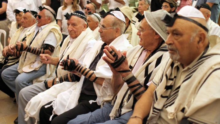 Holocaust survivors celebrate their belated Bar Mitzvah at the Western Wall in Jerusalem's Old City in October 2012, having been unable to mark the event  at the traditional age of 13 (photo credit: Yoav Ari Dudkevitch/Flash90)