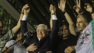 Mahmoud Abbas celebrating the return of Palestinian prisoners in August 2013 (photo credit:  Issam Rimawi/Flash90)