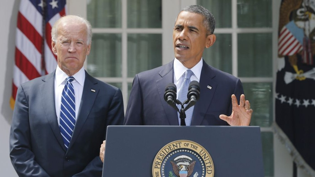 President Barack Obama stands with Vice President Joe Biden as he makes a statement about Syria in the Rose Garden at the White House in Washington, Saturday, Aug. 31, 2013. (Photo credit: AP Photo/Charles Dharapak)