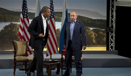 US President Barack Obama, left, and Russian President Vladimir Putin, June 17, 2013 (photo credit: AP/Evan Vucci)