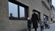 A Haredi father walks his children to Antwerp's Jesode Hatorah school, which  has refused to comply with Belgian educational requirements. (Cnaan Liphshiz/JTA)
