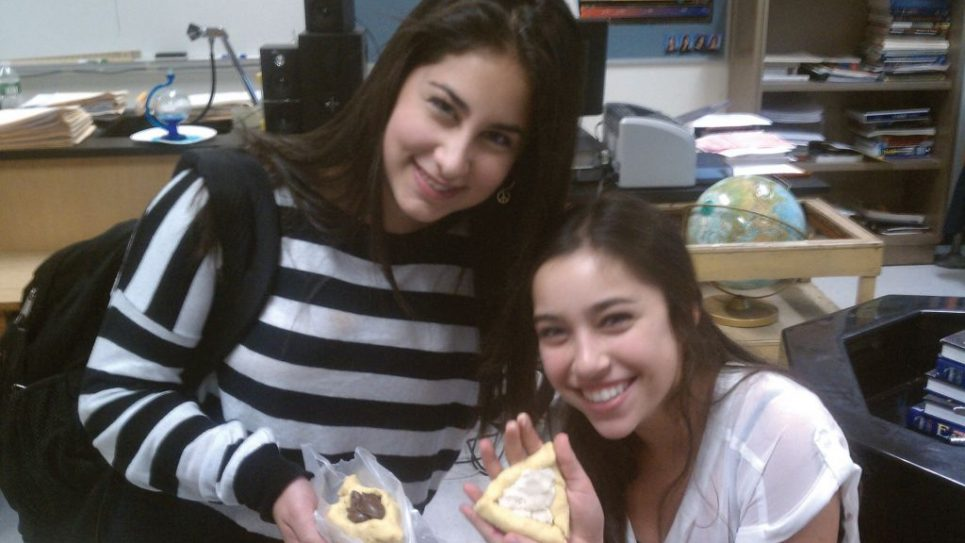 Members of New Rochelle High's Jewish Club make hamantaschen. Photo courtesy Jewish Student Connection