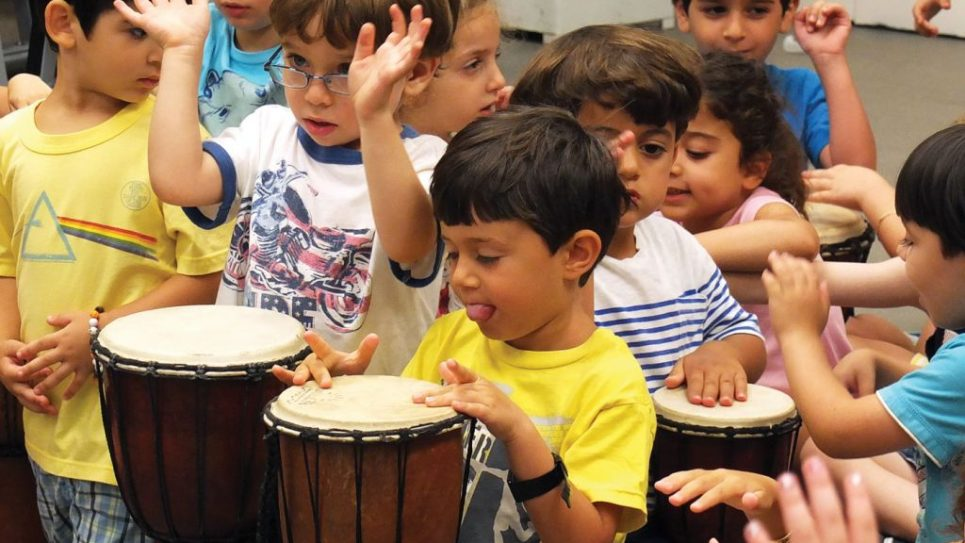 Little ones get into the bongo groove.