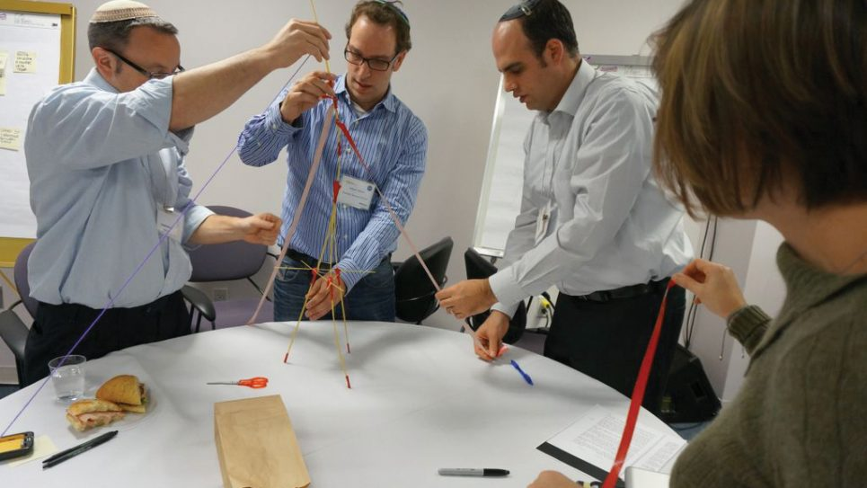 Rabbi Stephen Knapp, left, Adam Tilove and Ari Yares, lead educators in a workshop. Photo courtesy Jewish Education Project