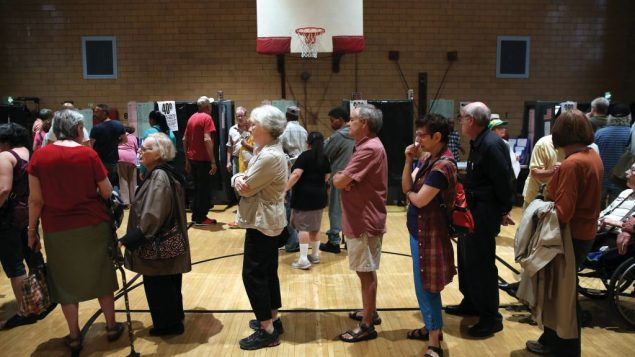 Voters cue up at a polling station in Manhattan to choose candidates in Tuesday's primary. Getty Images