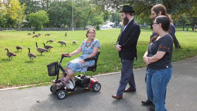 """""""It's not a shul — yet,"""" says Rabbi Herschel Hartz, center, about the new Inwood Jews group. Michael Datikash"""