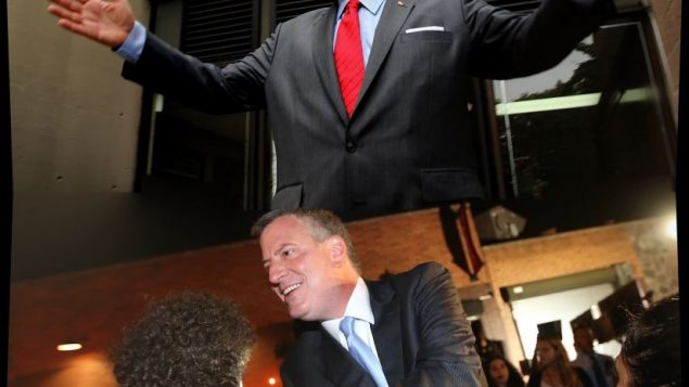 Joe Lhota, top, and Bill de Blasio exchanged veiled barbs in their victory speeches Tuesday night. Getty Images