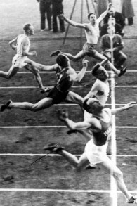 Finish line shot of the 1938 100 meter race at Helsinki Olympic Stadium. The winner Abraham Tokazier (closest to the camera) was declared fourth due to anti-Semitism. First published on June 22, 1938, in Helsingin Sanomat. (Photo credit: public domain, via Wikipedia)