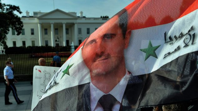 A rally outside the White House, above, protests a possible U.S. attack on regime of Bashar Assad. Getty Images