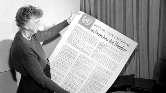 Eleanor Roosevelt holds a copy of the Universal Declaration of Human Rights, which she helped foster, in 1948. Photo courtesy UN