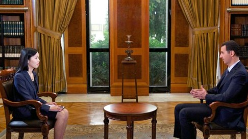 Bashar Assad speaks to China's CCTV in Damascus, September 23 (photo credit: AP Photo/SANA)