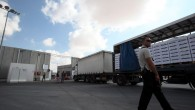 An Israeli security guard inspects goods at the Kerem Shalom Crossing before transferring them to the Gaza Strip, July 1, 2010 (photo credit: Yossi Zamir/Flash90)