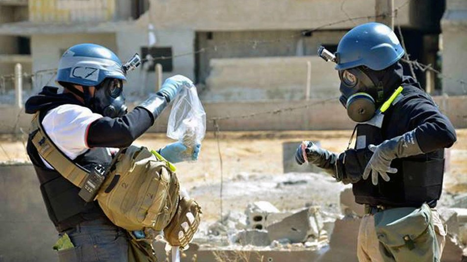 Members of a UN investigative team take samples near the site of an alleged chemical weapons attack, in Syria, August 28, 2013. (photo credit: AP/United Media Office of Arbeen)