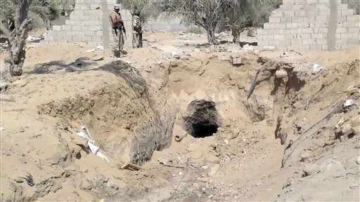 Egyptian Army personnel supervise the destruction of tunnels between Egypt and the Gaza Strip at the border, near the town of Rafah, northern Sinai, Egypt, Tuesday Sept. 3, 2013 (photo credit: AP/AP Television)