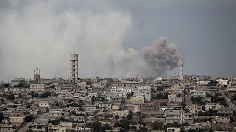 Smoke rises after a bomb was thrown from a helicopter, hitting a rebel position during heavy fighting between troops loyal to president Bashar Assad and opposition fighters, in Idlib province, Syria Thursday, Sept. 19, 2013 ,(photo credit: AP)