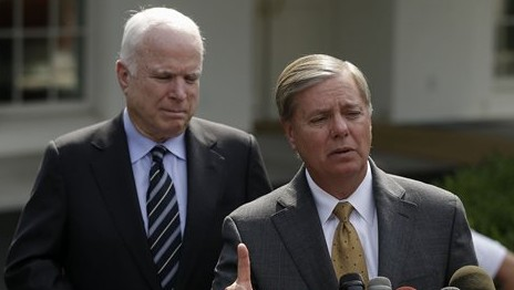 Senator Lindsey Graham, right, accompanied by Senator John McCain, speaks with reporters outside the White House in Washington, D.C., in September 2013. (photo credit: AP/Pablo Martinez Monsivais)