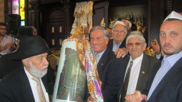 Rabbi Nisarov, community and political leaders their growing synagogue. Photo courtesy Congregation Bet-El