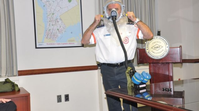Guy Caspi demonstrates a purified air respirator for Westchester emergency responders. Photo courtesy Magen David Adom