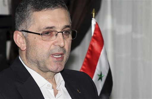 Ali Haider, the Syrian Minister for Reconciliation Affairs, speaks during an interview with The Associated Press in Damascus, Syria on Sept. 11, 2013 (photo credit: AP)