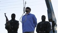 File: A blindfolded man waits to be hanged in public as two police officers look on in Shiraz, Iran, April 16, 2011. (AP/Mehr News Agency/Mohammad Hadi Khosravi)