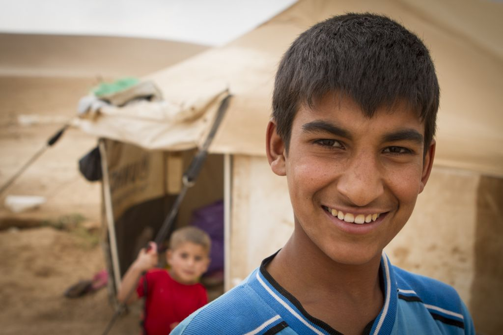 A Syrian boy and his brother in front of their tent. (photo credit: Mickey Alon)