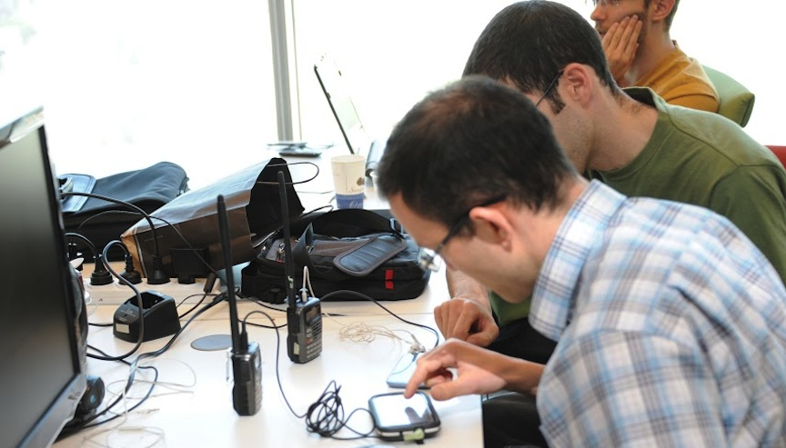 Lotem unit members tinker with electronic devices in order to secure them for field use (Photo credit: IDF Spokesperson)