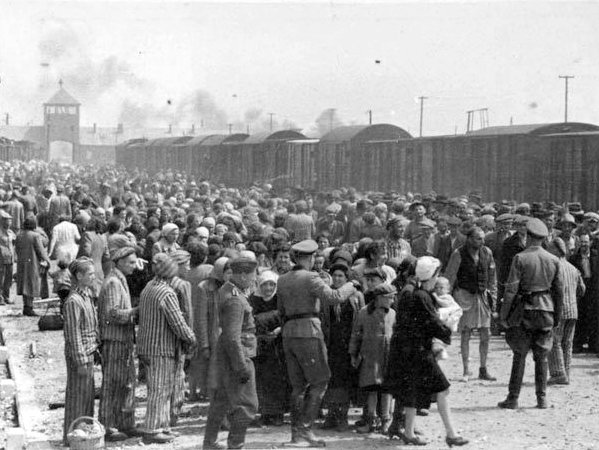 Hungarian Jews on the Judenrampe (Jewish ramp) after disembarking from the transport trains at Auschwitz-Birkenau, May 1944. To be sent rechts! – to the right – meant the person had been chosen as a laborer; links! – to the left – meant death in the gas chambers. (Photo credit: From the Auschwitz Album)