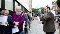 Raymond Simonson greets visitors at the opening of London's new JW3 community center. Blake Ezra Photography