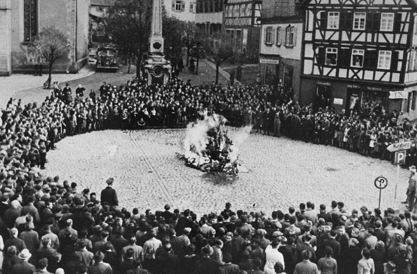 Schoolchildren and others brought to watch the burning of synagogue furnishings on Kristallnacht in Mosbach, Germany, November 1938 (courtesy)