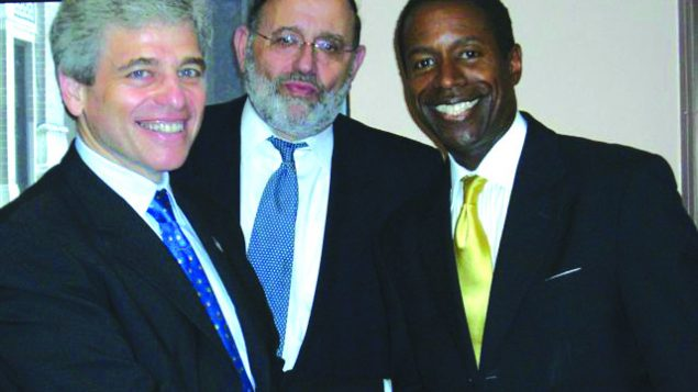 Rabbi David Cohen, center, with former Met Council head William Rapfogel and State Sen. Malcolm Smith