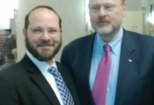 Republican underdog Joseph Lhota speaks with Rabbi Yaakov Lehrfield, left, of the Young Israel of Staten Island. Adam Dickter