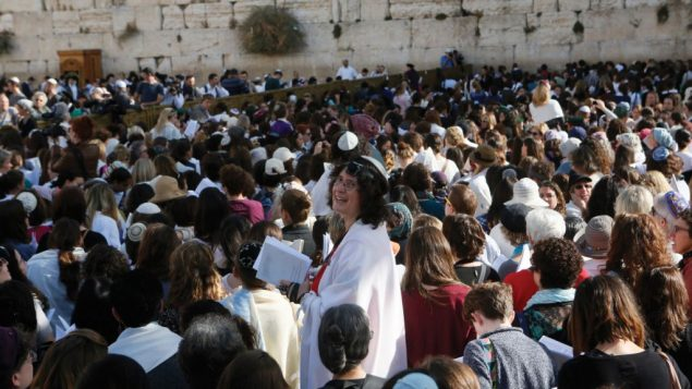 Hundreds of women gather Monday in the women's section at the Western Wall in Jerusalem. Miriam Alster