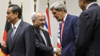 U.S. Secretary of State John Kerry and Iranian Foreign Minister Mohammad Javad Zarif negotiate in Geneva. Getty Images