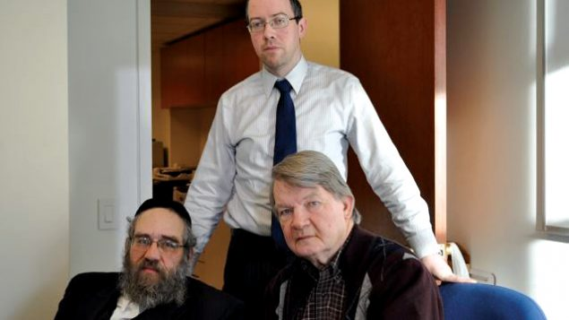 Sam Kellner, seated at left, with his attorneys Michael Dowd, seated at right, and Niall MacGiollabhui. Hella Winston