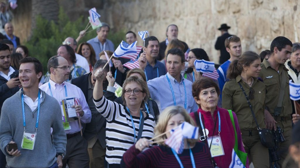 Members of the US Jewish Federations march near the Old City walls during the US Federations' General Assembly final ceremony in Jerusalem, November 12, 2013. (Photo credit: Yonatan Sindel/Flash90)