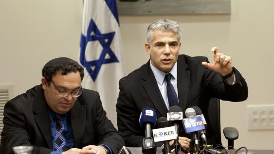 Education Minister Shai Piron (L) and Finance Minister Yair Lapid,  November 18, 2013 (photo credit: Flash90)