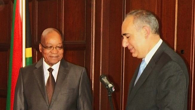 Israeli Ambassador to South Africa Arthur Lenk, right, hands his letter of credence to South African President Jacob Zuma, October 16, 2013 (photo credit: Ilana Lenk)