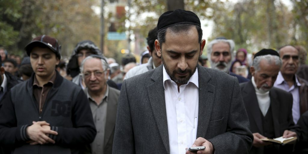 Iranian Jewish men pray in Hebrew during a gathering of Iran's Jewish community in support of their country's nuclear program in Tehran, Iran, Tuesday, November 19, 2013. (photo credit: AP/Ebrahim Noroozi)