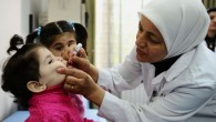 In this Tuesday, Oct. 29, 2013 file photo released by UNICEF, a health worker administers polio vaccine to a child as part of a UNICEF-supported vaccination campaign at the Abou Dhar Al Ghifari Primary Health Care Center in Damascus, Syria. (photo credit: AP/UNICEF, Omar Sanadiki)