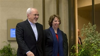 EU High Representative for Foreign Affairs Catherine Ashton, right, and Iranian Foreign Minister Mohammad Javad Zarif, arrive for a photo opportunity prior to the start of nuclear talks in Geneva, Switzerland, November 2013 (photo credit: AP/Keystone/Salvatore Di Nolfi)