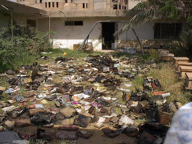 Thousands of waterlogged Jewish books and documents shortly after their discovery in a flooded basement of Saddam Hussein's former intelligence headquarters, May 2003. (Photo credit: courtesy The National Archives)