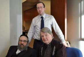 Sam Kellner, left, with lawyers Michael Dowd, seated, and Nial McGiollabui. Hella WInston